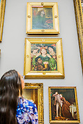 The return and re-hanging of the nation's Pre-Raphaelite works, including Millais' Ophelia, to Tate Britain. They are going back on display from Thursday 7 August 2014 after being seen by over 1.1 million people worldwide. They include: John Everett Millais' , Ophelia; Beata Beatrix  (pictured top) by Dante Gabriel Rossetti; The Lady of Shalott by John William Waterhouse; The Beloved by Rossetti (pictured middle); and Mariana by John Everett Millais. These works are being displayed in the 'grand' surroundings of the 1840 galleries as part of the BP Walk through British Art. <br /> Millbank,  London, UK.