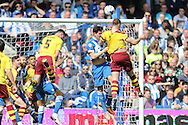 Burnley striker Sam Vokes (9) and Brighton central defender, Lewis Dunk (5) battle during the Sky Bet Championship match between Brighton and Hove Albion and Burnley at the American Express Community Stadium, Brighton and Hove, England on 2 April 2016.
