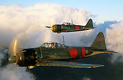 Mistubishi A6M Zero fighters, Japan, WW II,  Not replicas.  Being flown in film PEARL HARBOR by Steve Hinton and Steve Barber.