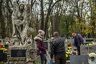 People remember their deceased loved ones at Rakowicki Cemetery in Krakow, Poland in 2019.