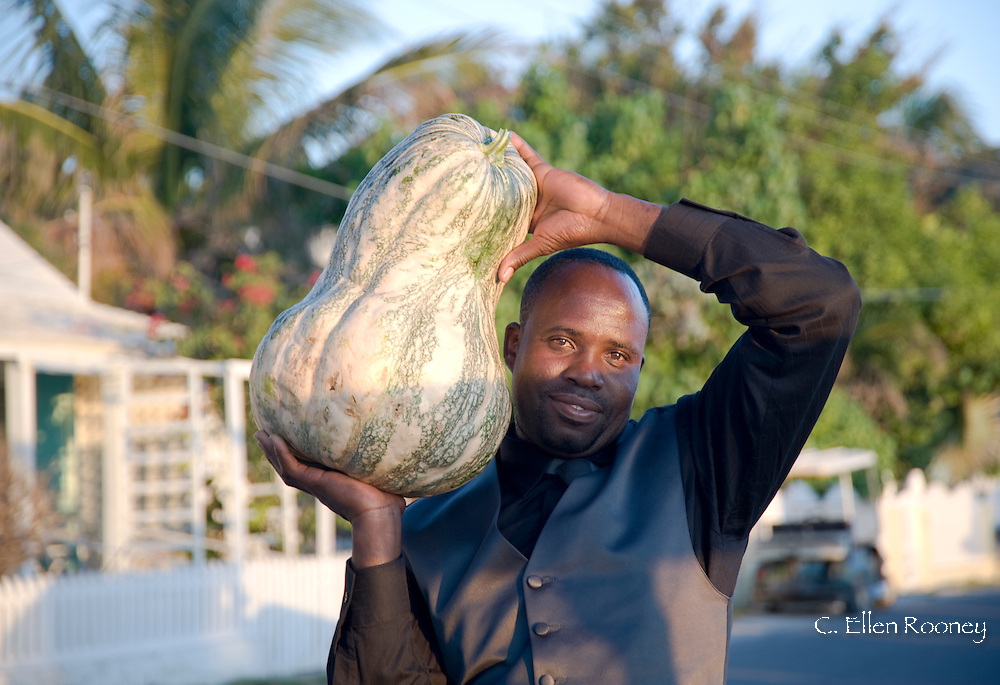 A man carrying a large gourd in Dunmore Town, Harbour Island, The Bahamas