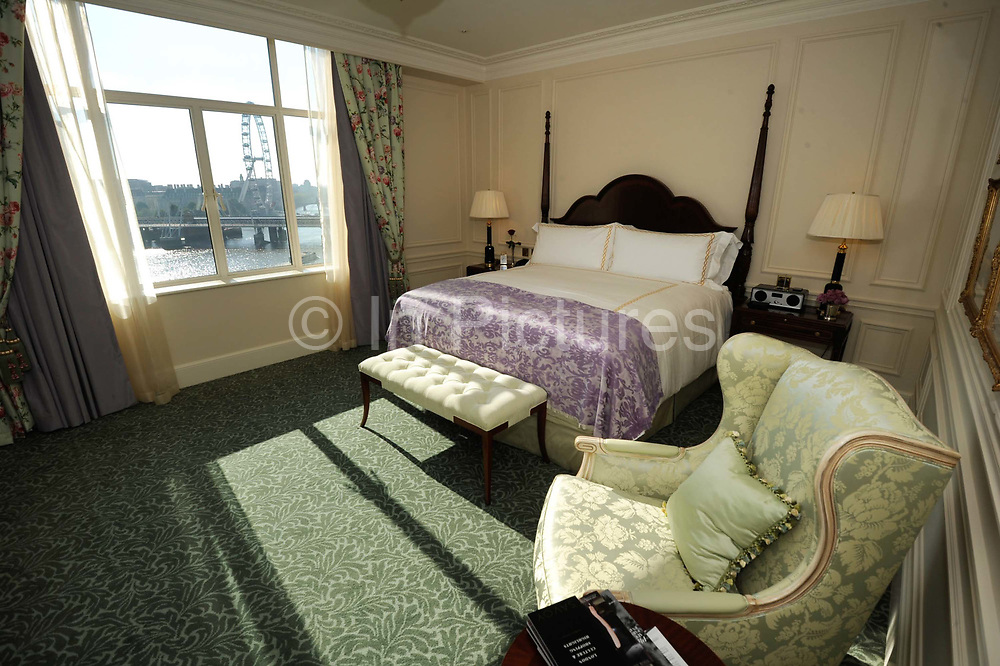 """One of the bedrooms with Thames river views at the Savoy Hotel. The iconic hotel reopened after a three year refit that cost £220 million ($350 million). The Savoy Hotel is a located on the Strand, in central London. Built by impresario Richard D'Oyly Carte the hotel opened on 6 August 1889. It was the first in the Savoy group of hotels and restaurants owned by Carte's family for over a century. It has been called """"London's most famous hotel"""" and remains one of London's most prestigious and opulent hotels, with 268 rooms and panoramic views of London."""