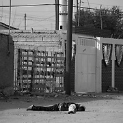 A young man murdered with assault rifles in one of the poorer neighbourhoods in Ciudad Juarez, Mexico.(Credit Image: © Louie Palu/ZUMA Press)December 2011