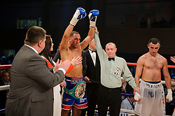 James DeGale (blue shorts) celebrates after winning with an 11th round stoppage over Gevorg Khatchikian (white shorts) to defend his WBC Silver super middleweight title<br /> - Photo mandatory by-line: Rogan Thomson/JMP - Tel: 07966 386802 - 01/03/2014 - SPORT - BOXING - The City Academy, Bristol - James DeGale v Gevorg Khatchikian.
