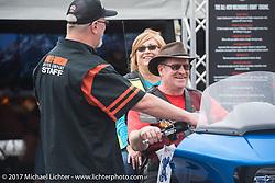 Trying out a new 2017 FLH bagger at the Harley-Davidson display at the Daytona Speedway during Daytona Bike Week. Daytona Beach, FL. USA. Monday March 13, 2017. Photography ©2017 Michael Lichter.