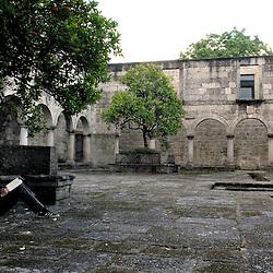Santa Maria Do Bourho, Portugal - A guest visiting the former Cistercian monastery of Santa Maria Do Bourho sketches in the empty courtyard..Photo by Susana Raab