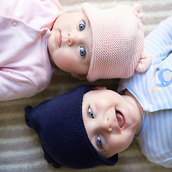 Elevated View of Twin Babies Lying on Back Facing Opposite Directions