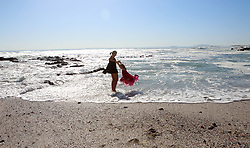 """South Africa - Cape Town - 17 June 2020 - Olivia Burton and Azora Kayli-Quani (7) having fun Along the Sea Point Promenade soaking up the sunlight, and enjoying the warm day following a few rainy days Picture"""" Brendan Magaar/African News Agency(ANA)"""