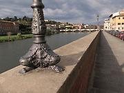 Lungarno delle Grazie street next to the Arno River with the Ponte delle Grazie in the distance
