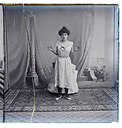 young adult woman standing with hands open a natural light indoors studio Paris France early 1900s