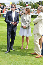Left to right, JACK BROOKSBANK, HRH PRINCESS EUGENIE OF YORK and the EARL OF MARCH at the Qatar Goodwood Festival - Ladies Day held at Goodwood Racecourse, West Sussex on 30th July 2015.