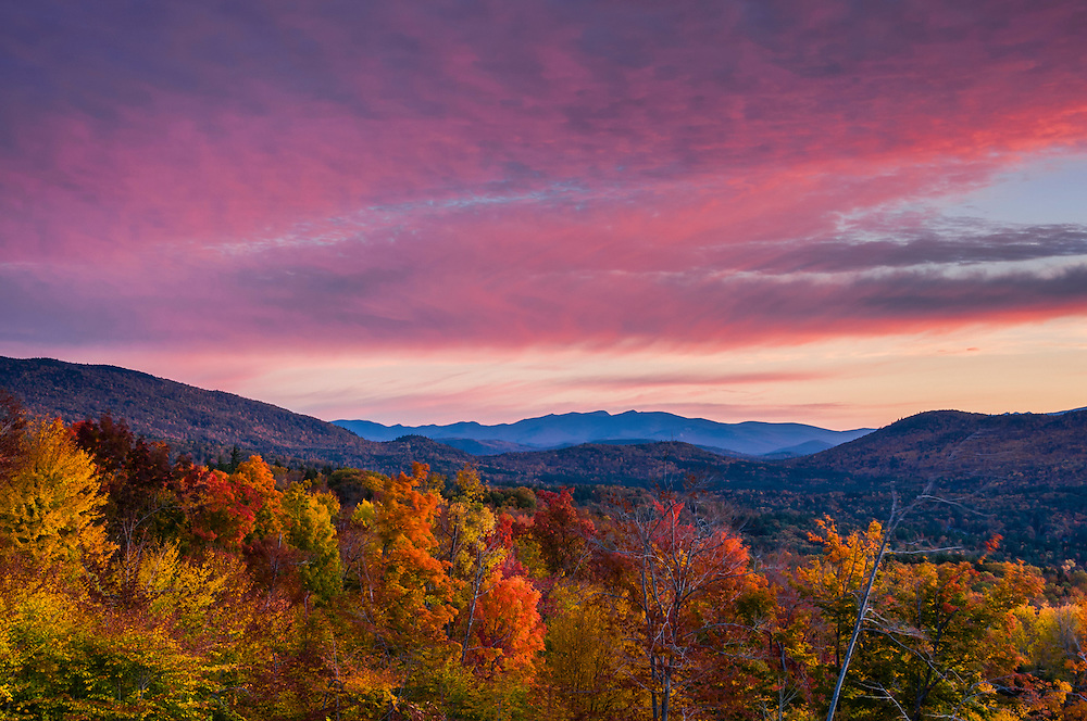 Mountain ridgelines, Mt Tecumseh, fall colors in foreground, pink sky at dawn, Hebron, NH