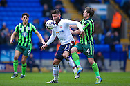 Bolton Wanderers striker Gary Madine (14) holds of the challenge from AFC Wimbledon midfielder Dannie Bulman (4)  during the EFL Sky Bet League 1 match between Bolton Wanderers and AFC Wimbledon at the Macron Stadium, Bolton, England on 4 March 2017. Photo by Simon Davies.