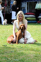 CLARE CONNELL and her dog Purdey at the Macmillan Dog Day in aid of Macmillan Cancer Support held at the Royal Hospital Chelsea, London on 8th July 2008.<br />