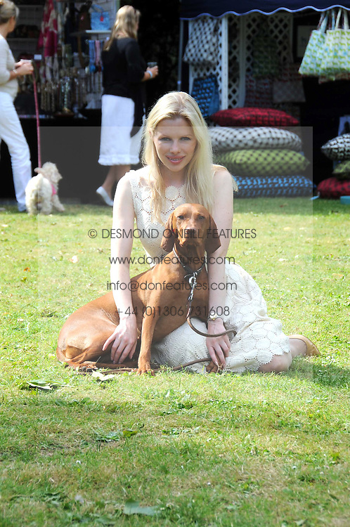 CLARE CONNELL and her dog Purdey at the Macmillan Dog Day in aid of Macmillan Cancer Support held at the Royal Hospital Chelsea, London on 8th July 2008.<br /><br />NON EXCLUSIVE - WORLD RIGHTS