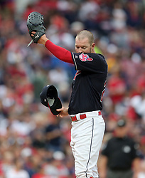 October 6, 2017 - Cleveland, OH, USA - Cleveland Indians starting pitcher Corey Kluber wipes his face while pitching against the New York Yankees in the first inning during Game 2 of the American League Division Series, Friday, Oct. 6, 2017, at Progressive Field in Cleveland. (Credit Image: © Phil Masturzo/TNS via ZUMA Wire)