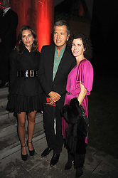 Left to right, DASHA ZHUKOVA, MARIO TESTINO and MOLLIE DENT-BROCKLEHURST at the annual Serpentine Gallery Summer Party in Kensington Gardens, London on 9th September 2008.