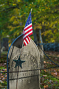 War of 1812 cemetery headstone medallion and American flag, afternoon light, October, Hillsborough County, Hancock, New Hampshire, USA
