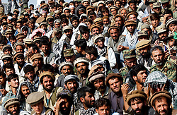 KABUL,AFGHANISTAN - SEPT. 9:  Afghans watch a ceremony in Kabul Sports Stadium September 9, 2002  to comemerate the anniversary of the death of Ahmad Shah Massoud in Kabul, Afghanistan. (Photo by Ami Vitale/Getty Images)