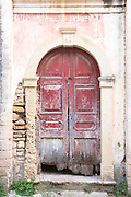 Shabby front door of house in ancient village of Peroulades in Northern Corfu, , Greece