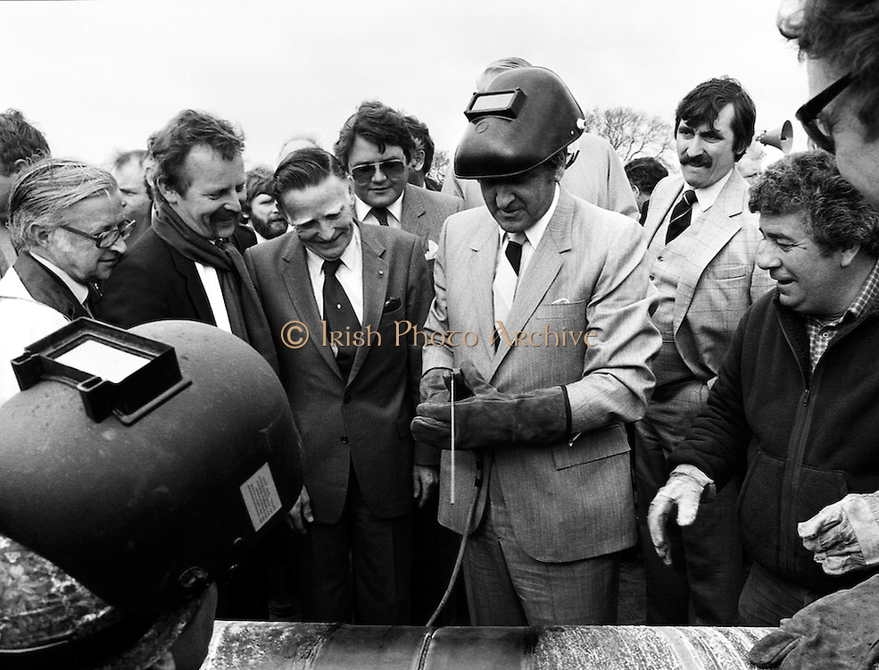 Albert Reynolds TD, Minister for Industry and Energy, performs the ceremonial first weld at Brownbarn, Kingswood, Dublin, officially starting work on the new Cork–Dublin gas pipeline.<br />