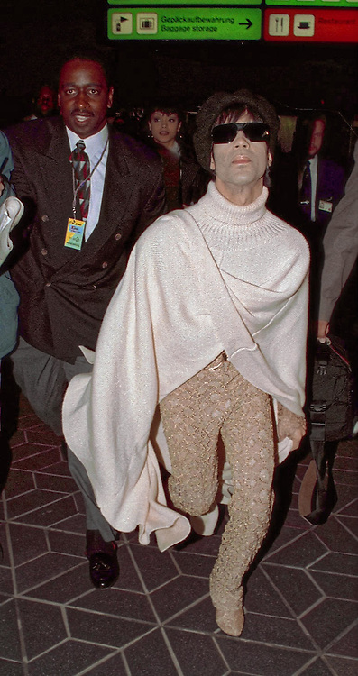 Berlin, Germany - 22 November 1994<br /> Musician Prince / TAFKAP / Prince Rogers Nelson arriving at Berlin airport before performing for the MTV Music Awards 1994<br /> (photo by: EDWARD HIRST / EQUINOXFEATURES.COM)<br /> Picture Data:<br /> Photographer: Edward Hirst<br /> Copyright: ©1994 Equinox Licensing Ltd. +448700 780000<br /> Contact: Equinox Features<br /> Date Taken: 00041122<br /> Time Taken: 165858<br /> www.newspics.com