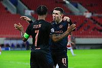 PIRAEUS, GREECE - NOVEMBER 25: Phil Foden of Manchester City celebrates his goal with Raheem Sterling of Manchester City during the UEFA Champions League Group C stage match between Olympiacos FC and Manchester City at Karaiskakis Stadium on November 25, 2020 in Piraeus, Greece. (Photo by MB Media)