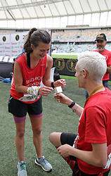 10062018 (Durban) David propose to Claire at the finnish line at the Mosses Mabhida stadium venue during the Comrades Marathon on Sunday as Bong'musa Mthembu and Ann Ashworth ensured that the coveted titles remained on these shores.<br /> Picture: Motshwari Mofokeng/African News Agency/ANA