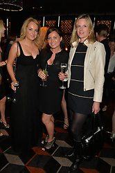 Left to right, SUZANNE KERINS, TRACEY BUNN and MEL BRODIE editor of the Sunday Mirror's Celebs magazine at a party to celebrate the publication of Behind The Mask by Emma Sayle held at The Playboy Club, 14 Old Park Lane, London on 23rd April 2014.
