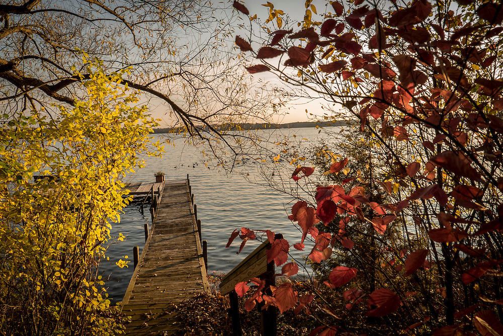 """This autumn pier photo was taken in Wisconsin's """"Lake Country"""".  Wisconsin's <br /> """"Lake Country"""" is an area of northwestern Waukesha county with a large number of lakes.  Pewaukee, Delafield, Hartland, Merton, Nashotah, Chenequa, Okachee Lake, Oconomowoc, Summit and Lac La Belle make up Wisconsin's """"Lake Country""""."""