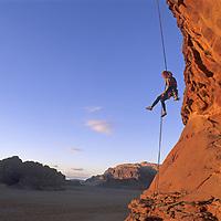 Mountaineer Lisa Gnade rappels off Jebel (Mount) Khaz Ali in Jordan's Wadi Rum, a spectacular part of the Arabian Desert.