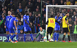 Watford's Abdoulaye Doucoure (centre) celebrates scoring his side's first goal of the game during the Premier League match at the Cardiff City Stadium.