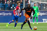 Antoine Griezmann competes for the ball with Eliaquim Mangala of Valencia CF  during the match of Spanish La Liga between Atletico de Madrid and Valencia CF at  Vicente Calderon Stadium in Madrid, Spain. March 05, 2017. (ALTERPHOTOS / Rodrigo Jimenez)
