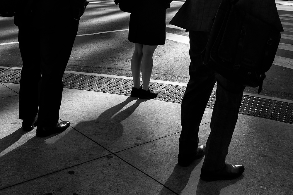 This image came together at a stoplight on the corner of Front Street and Bay during the morning rush. The beautiful light reflecting off the Royal Bank Tower and how the light became a backlight for the intersection attracted me. Using this light I photographed people waiting at the intersection and in this case the juxtaposition was interesting between the three sets of legs. I almost missed this image in my files, only finding it after reviewing my raw image files for a second time. This shows how editing must be detailed and that you must review files even if initially discarded. The other aspect I liked about this photograph was the woman's legs in front of the two mans, suggesting a leadership role.
