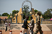 """Soldiers and civilians walk past the Garden of Semicentennial, a small park celebrating the 50th anniversary of the independence of Central African Republic (CAR) in Bangui, the capital city. The statues represent six former presidents including François Bozizé, far right with the missing name plate, the deposed president who fled the country after the Séléka rebels seized power by a military coup back in March 24, 2013. Séléka, meaning """"union"""" or """"allegiance"""" in Sango language, propelled the current CAR interim President Michel Djotodia into power Séléka forces are still causing instability in the country, waging battles with pro-Bozizé supporters known as Anti-Balaka to this date. The insecurity drove the country into total chaos in almost every sector, as its citizens merely try to survive from day to day. Already one of the poorest countries in the world, CAR's future looks bleaker than it ever has in the past."""