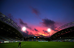 The sun sets behind the ground after the match