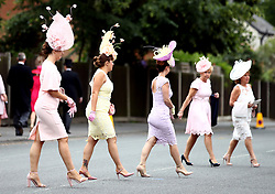 Female racegoers arrive for day one of Royal Ascot at Ascot Racecourse.