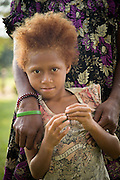Child at market, Tufi, Cape Nelson, Oro Province, Papua New Guinea