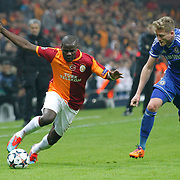 Galatasaray's Emmanuel Eboue (L) and Chelsea's Andre Schurrle (R) during their UEFA Champions League Round of 16 First leg soccer match Galatasaray between Chelsea at the AliSamiYen Spor Kompleksi in Istanbul, Turkey on Wednesday 26 February 2014. Photo by Aykut AKICI/TURKPIX