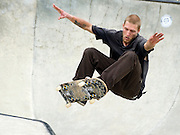 PRICE CHAMBERS / NEWS&GUIDEMatt Winskowski makes it look easy as he catches air off a lip in the bowl Saturday at the Wild West Skateboard Contest series.