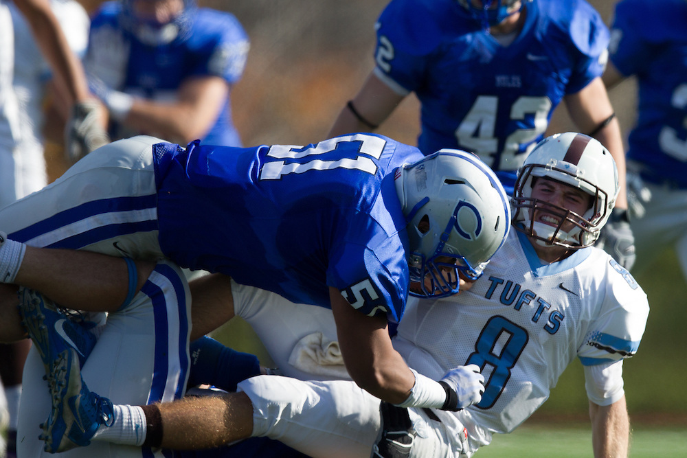 Caleb Harris and Jac-Antoine Muntu-Caron, of Colby College, during a NCAA Division III football game on November 2, 2013 in Waterville, ME. (Dustin Satloff/Colby College Athletics)
