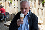 senior man enjoying a soft ice cream