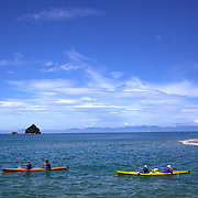 People kayaking on crystal clear waters of Abel Tasman National Park, South Island, New Zealand, 5th February 2011. Photo Tim Clayton..