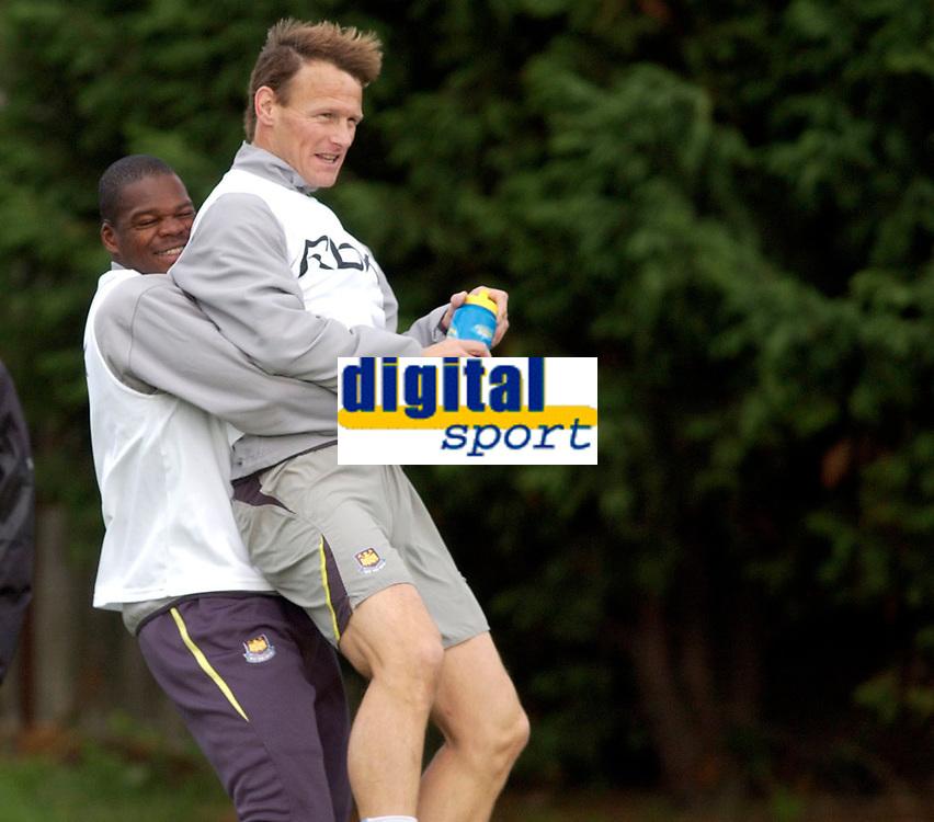 Photo: Daniel Hambury.<br />West Ham Utd Training. 03/11/2005.<br />Marlon Harewood (L) gives Teddy Sheringham a lift during training.