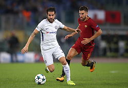 Chelsea's Cesc Fabregas (left) and Roma's Kevin Strootman battle for the ball
