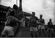 04/09/1960<br /> 09/04/1960<br /> 4 September 1960 <br /> All-Ireland Final: Tipperary v Wexford at Croke Park, Dublin.<br /> Tipperary player, Tom Ryan, tries to get past Wexford's defence.