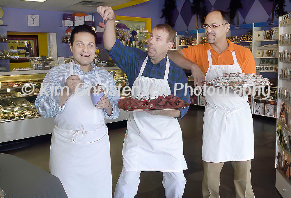 Getting a little chocolate crazy Eric Shamban, Gilbert Johnson and Tino Ramirez clown around in their at store called The Chocolate Bar and Candylicious on Alabama, 11/13/03.  (Photo by Kim Christensen)