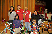 Faculty and staff as well as a school sponsor donated gifts for Bonner ES students. Several gifts and bicycles were donated. Teachers selected the students who attended the Christmas celebration. The student names were placed in the drawing to win a bicycle.<br />