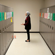 """Southview student Oumeima Djema practices her recitation of Suzanne Barakat's """"Islamophobia killed my brother. Let's end the hate."""" speech about Barakat's 2015 loss of her brother and sister-in-law in Chapel Hill, N.C., for a declamation speech during practice at the Ohio Speech and Debate Association state tournament at Southview High School in Sylvania, Ohio, on Friday, March 2, 2018. Djema and the other participants in the tournament often practice the speeches and performances facing walls, lockers or empty rooms. THE BLADE/KURTSTEISS"""