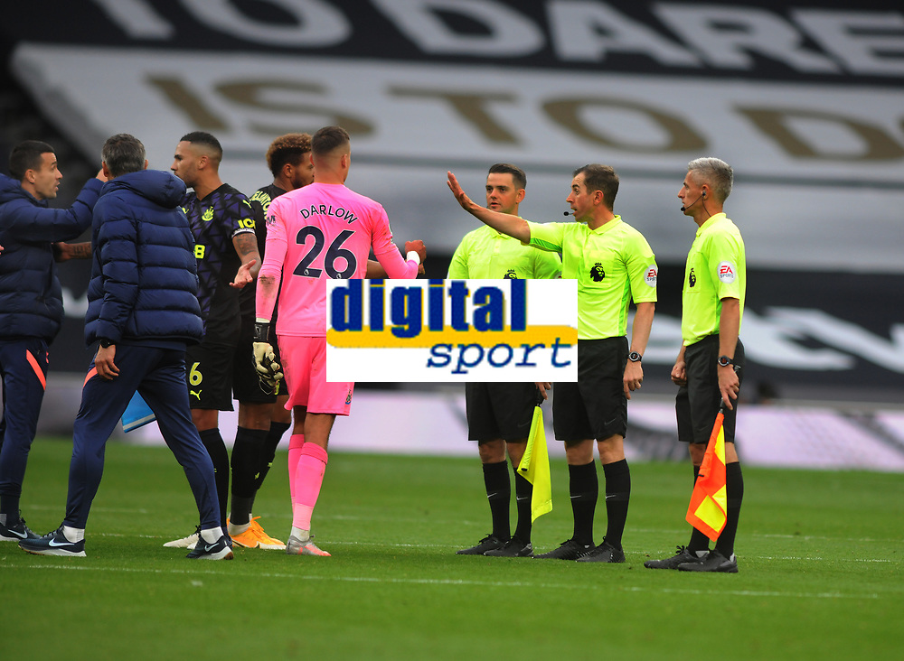 Football - 2020 /2021 Premier League - Tottenham Hotspur vs Newcastle United<br /> <br /> Referee, Peter Bankes, tells players to walk away after the match  at the Tottenham Hotspur Stadium.<br /> <br /> COLORSPORT/ANDREW COWIE